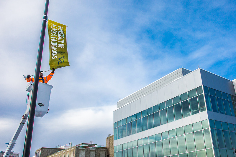 "A crew from UAF's Facilities Services monts new banners at various locations on the Fairbanks campus.  <div class=""ss-paypal-button"">Filename: CAM-13-3722-60.jpg</div><div class=""ss-paypal-button-end"" style=""""></div>"