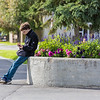 "A student checks in with his smart phone while waiting for a friend in front of Wood Center on the Fairbanks campus.  <div class=""ss-paypal-button"">Filename: CAM-15-4638-061.jpg</div><div class=""ss-paypal-button-end""></div>"