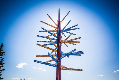 The milepost sign in front of UAF's Gephysical Institute serves as a local landmark.  Filename: CAM-12-3414-01.jpg