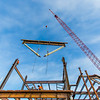 "A 220-foot crane lowers steel beams into position as workers wait to attach it during construction of the new engineering facility on the Fairbanks campus in April, 2014.  <div class=""ss-paypal-button"">Filename: CAM-14-4131-13.jpg</div><div class=""ss-paypal-button-end""></div>"