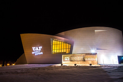 The branding tagline is projected onto the wall of the museum.  Filename: CAM-12-3636-1.jpg