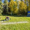 "Employees with UAF's grounds crew paint the brand slogan on the lawn near the west entrance to campus.  <div class=""ss-paypal-button"">Filename: CAM-12-3539-01.jpg</div><div class=""ss-paypal-button-end"" style=""""></div>"