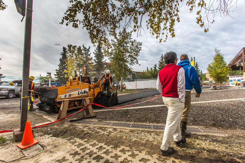 """Students make their way past construction workers laying down fresh blacktop as they head into Wood Center this afternoon. The work is one of many construction projects currently underway as students show up on the first day of classes for the fall semester.  <div class=""""ss-paypal-button"""">Filename: CAM-13-3928-297.jpg</div><div class=""""ss-paypal-button-end"""" style=""""""""></div>"""