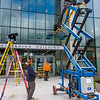 "A crew from Hoffer Glass installs panels on the entry way to the new engineering building on the Fairbanks campus in August 2015.  <div class=""ss-paypal-button"">Filename: CAM-15-4634-034.jpg</div><div class=""ss-paypal-button-end""></div>"