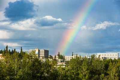 A rainbow appears over the Fairbanks campus during an evening shower at the start of the Fourth of July weekend.  Filename: CAM-16-4931-2.jpg