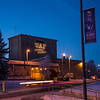 """The tagline """"Naturally Inspiring"""" is illuminated on the outside wall of UAF's Salisbury Theatre on a cold winter evening.  <div class=""""ss-paypal-button"""">Filename: CAM-12-3678-7.jpg</div><div class=""""ss-paypal-button-end"""" style=""""""""></div>"""
