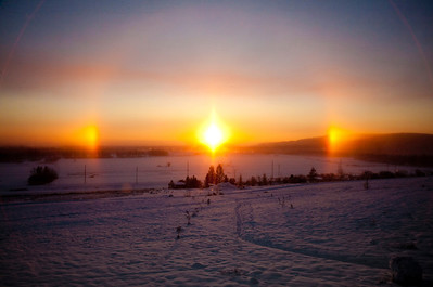 A colorful sundog shines over the agricultural fields on the Fairbanks campus.  Filename: CAM-10-2946-06.jpg