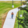 "A lone cyclist makes his way along a sidewalk on UAF's West Ridge.  <div class=""ss-paypal-button"">Filename: CAM-12-3505-07.jpg</div><div class=""ss-paypal-button-end"" style=""""></div>"