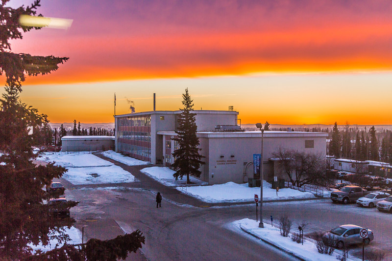 """A brilliant sunrise brightens the sky southeast of the Bunnell Building on the Fairbanks campus at about 9:15 a.m. on Wednesday, Feb. 5.  <div class=""""ss-paypal-button"""">Filename: CAM-14-4061-5.jpg</div><div class=""""ss-paypal-button-end"""" style=""""""""></div>"""
