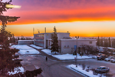 A brilliant sunrise brightens the sky southeast of the Bunnell Building on the Fairbanks campus at about 9:15 a.m. on Wednesday, Feb. 5.  Filename: CAM-14-4061-5.jpg