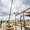"Iron workers with Davis Constructors prepare to place the final steel beam into position in UAF's new engineering facility this afternoon while a crowd of university, legislative and business leaders look on. The final piece of steel is topped with Alaska and U.S. flags and, following an ancient  Scandinavian tradition, a small tree.  <div class=""ss-paypal-button"">Filename: CAM-14-4199-108.jpg</div><div class=""ss-paypal-button-end""></div>"