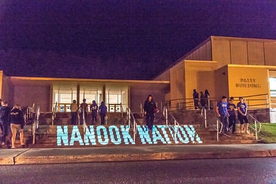 Student volunteers walk in and out of the Patty Center during a late night promotional multi-media production introducing the Nanook Nation theme.  Filename: CAM-13-3925-136.jpg