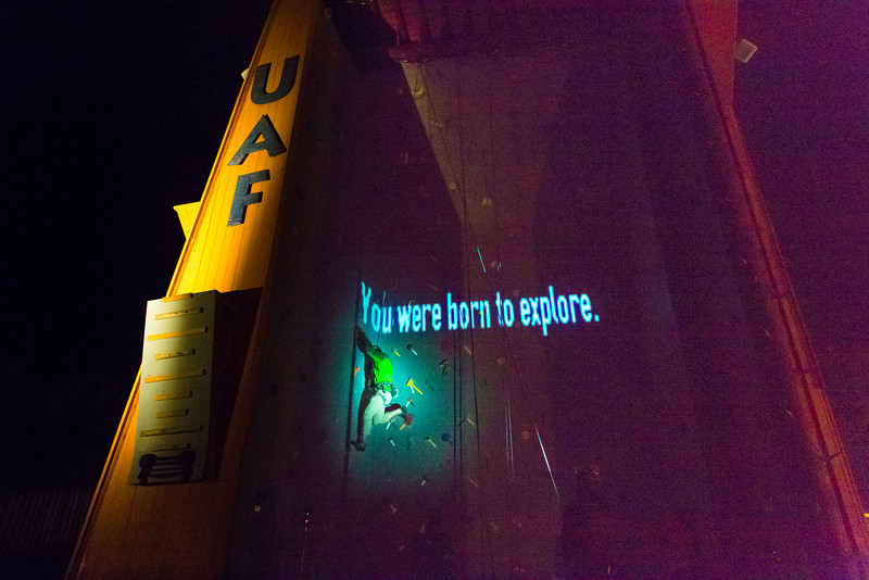 "A video image is projected on UAF's outdoor climbing wall while a student climber makes his way up the route during a late night promotional multi-media production.  <div class=""ss-paypal-button"">Filename: CAM-13-3925-103.jpg</div><div class=""ss-paypal-button-end"" style=""""></div>"