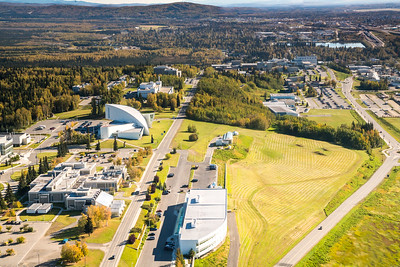 An aerial view of UAF looking east toward Fairbanks at about 11:25 a.m. on Sept. 10, 2016.  Filename: CAM-16-4992-115.jpg