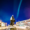 "A strand of light from the aurora borealis floats above the statue of Charles Bunnell and the Bunnell Building on the Fairbanks campus.  <div class=""ss-paypal-button"">Filename: CAM-13-3724-17.jpg</div><div class=""ss-paypal-button-end"" style=""""></div>"