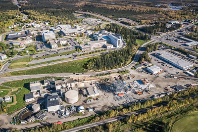 An aerial view of UAF's new combined heat and power plant being built adjacent to the existing unit that's been in service since the 1960s.  Filename: CAM-16-4992-069.jpg