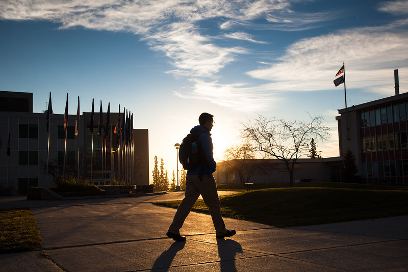 """A student walks toward the Bunnell Building on a sunny October morning.  <div class=""""ss-paypal-button"""">Filename: CAM-12-3575-10.jpg</div><div class=""""ss-paypal-button-end"""" style=""""""""></div>"""