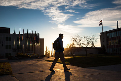 A student walks toward the Bunnell Building on a sunny October morning.  Filename: CAM-12-3575-10.jpg