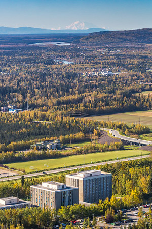 Denali is seen on the horizon with the Moore-Bartlett-Skarland student housing complex in the foreground in an aerial photograph taken about 11:20 on Sept. 10, 2016.  Filename: CAM-16-4992-083.jpg
