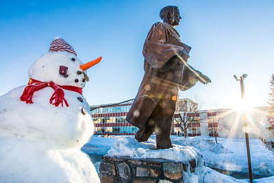 A stretch of warm Fairbanks weather in January 2014 was conducive to building snowmen around campus.  Filename: CAM-14-4049-8.jpg