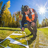 """Employees with UAF's grounds crew paint the brand slogan on the lawn near the west entrance to campus.  <div class=""""ss-paypal-button"""">Filename: CAM-12-3539-13.jpg</div><div class=""""ss-paypal-button-end"""" style=""""""""></div>"""