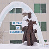 "The traditional ice arch, designed and built each year by students in UAF's civil engineering program, stands behind the statue of Charles Bunnell on a snowy March afternoon.  <div class=""ss-paypal-button"">Filename: CAM-12-3320-12.jpg</div><div class=""ss-paypal-button-end"" style=""""></div>"