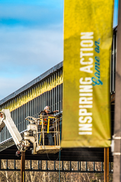 """A worker makes progress on the south wall of the Wood Center addition on the Fairbanks campus.  <div class=""""ss-paypal-button"""">Filename: CAM-13-3972-12.jpg</div><div class=""""ss-paypal-button-end"""" style=""""""""></div>"""