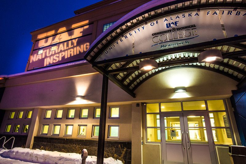 "The Naturally Inspiring tagline is projected onto the front of UAF's Community and Technical College at 604 Barnette St. in downtown Fairbanks.  <div class=""ss-paypal-button"">Filename: CAM-13-3703-9.jpg</div><div class=""ss-paypal-button-end"" style=""""></div>"