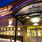 The Naturally Inspiring tagline is projected onto the front of UAF's Community and Technical College at 604 Barnette St. in downtown Fairbanks.