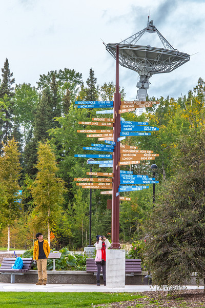 """Tourists to take photos of the well-known milepost in front of the International Arctic Research Center on UAF's West Ridge.  <div class=""""ss-paypal-button"""">Filename: CAM-13-3928-178.jpg</div><div class=""""ss-paypal-button-end"""" style=""""""""></div>"""