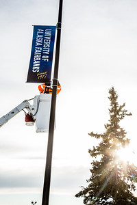 A crew from UAF's Facilities Services monts new banners at various locations on the Fairbanks campus.  Filename: CAM-13-3722-23.jpg
