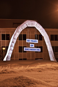 The 2012 ice arch stands temporarily lit up in Cornerstone Plaza.  Filename: CAM-12-3320-61.jpg