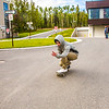 "A skateboarder zooms down the hill in front of Wood Center during Orientation Week on the Fairbanks campus at the start of the fall 2015 semester.  <div class=""ss-paypal-button"">Filename: CAM-15-4638-081.jpg</div><div class=""ss-paypal-button-end""></div>"