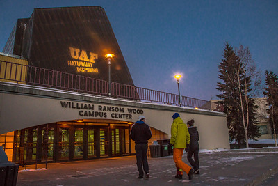 "UAF's ""Naturally Inspiring"" branding tagline is projected onto the exterior of Wood Center.  Filename: CAM-12-3657-8.jpg"