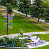 "Pedestrians make their way past the distinctive milepost sign on UAF's West Ridge.  <div class=""ss-paypal-button"">Filename: CAM-12-3505-38.jpg</div><div class=""ss-paypal-button-end"" style=""""></div>"