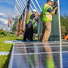"Students in a class on solar photovoltaic design and installation prepare to mount solar panels along the road near the Cold Climate Housing Research Center  near the Fairbanks campus. The class is offered through UAF's Community and Technical College.  <div class=""ss-paypal-button"">Filename: CAM-12-3467-17.jpg</div><div class=""ss-paypal-button-end"" style=""""></div>"