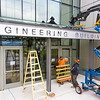 "A crew from Hoffer Glass installs panels on the entry way to the new engineering building on the Fairbanks campus in August 2015.  <div class=""ss-paypal-button"">Filename: CAM-15-4634-020.jpg</div><div class=""ss-paypal-button-end""></div>"