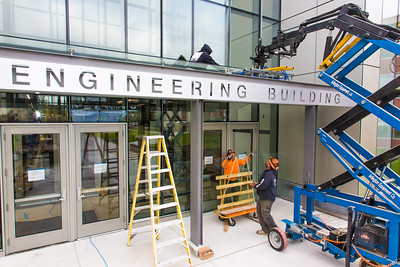 A crew from Hoffer Glass installs panels on the entry way to the new engineering building on the Fairbanks campus in August 2015.  Filename: CAM-15-4634-020.jpg