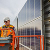 "Jeff Montgomery with Industrial Electric works on connecting new solar panels on the SRC into the building's electrical system.  <div class=""ss-paypal-button"">Filename: CAM-12-3568-46.jpg</div><div class=""ss-paypal-button-end"" style=""""></div>"