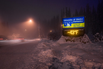 A frigid January morning on the Fairbanks campus as evidenced by the time and temperature sign on Alumni Drive.  Filename: CAM-13-3708-21.jpg