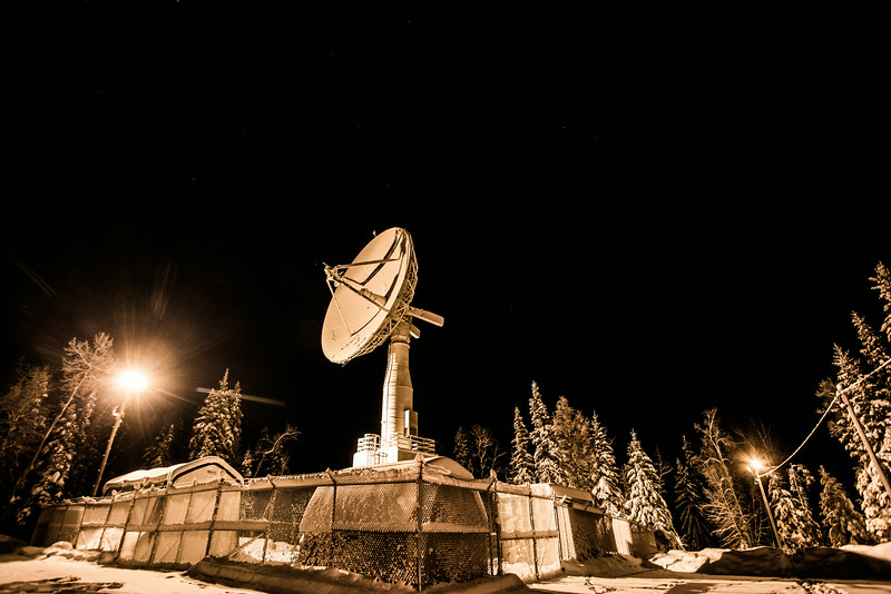 "The Alaska Satellite Facility's 11-meter antenna on West Ridge is mounted on a hillside near UAF's Geophysical Institute.  <div class=""ss-paypal-button"">Filename: CAM-13-4028-1.jpg</div><div class=""ss-paypal-button-end""></div>"
