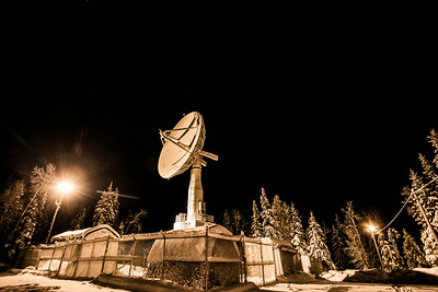 The Alaska Satellite Facility's 11-meter antenna on West Ridge is mounted on a hillside near UAF's Geophysical Institute.  Filename: CAM-13-4028-1.jpg