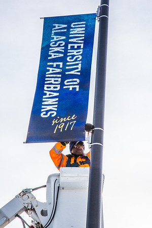 "A crew from UAF's Facilities Services monts new banners at various locations on the Fairbanks campus.  <div class=""ss-paypal-button"">Filename: CAM-13-3722-29.jpg</div><div class=""ss-paypal-button-end"" style=""""></div>"