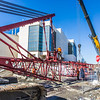 "Workers assemble the pieces of a 220-foot crane used to install steel beams on the new expansion of the Duckering Building.  <div class=""ss-paypal-button"">Filename: CAM-14-4122-24.jpg</div><div class=""ss-paypal-button-end"" style=""""></div>"