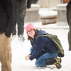 "With a snowball on hand, Justine Webb, eyes her friends as a perfect target at the Cornerstone Plaza during the first snowfall of the semester in mid-October 2012.  <div class=""ss-paypal-button"">Filename: CAM-12-3589-88.jpg</div><div class=""ss-paypal-button-end"" style=""""></div>"