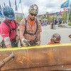 "Iron workers with Davis Constructors sign their names on the final steel beam before it's lifted into position in UAF's new engineering facility following a brief ceremony May 22. The final piece of steel is topped with Alaska and U.S. flags and, following an ancient  Scandinavian tradition, a small tree.  <div class=""ss-paypal-button"">Filename: CAM-14-4199-84.jpg</div><div class=""ss-paypal-button-end""></div>"