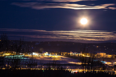A full moon rises over the UAF campus in late December.  Filename: CAM-12-3686-11.jpg
