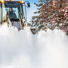 """A Facilities Services crew member uses some heavy equipment to sweep the sidewalk in front of Signers' Hall after a late winter snowfall.  <div class=""""ss-paypal-button"""">Filename: CAM-13-3786-6.jpg</div><div class=""""ss-paypal-button-end"""" style=""""""""></div>"""