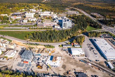 An aerial view showing UAF's new combined heat and power plant being built adjacent to the existing unit that's been in service since the 1960s.  Filename: CAM-16-4992-139.jpg