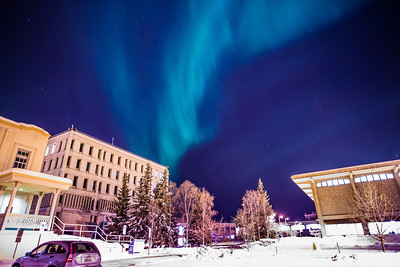 The aurora borealis floats above the Gruening Building and the rest of the Fairbanks campus.  Filename: CAM-13-3724-32.jpg